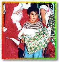 Niño en navidad. Nicolás Julio
